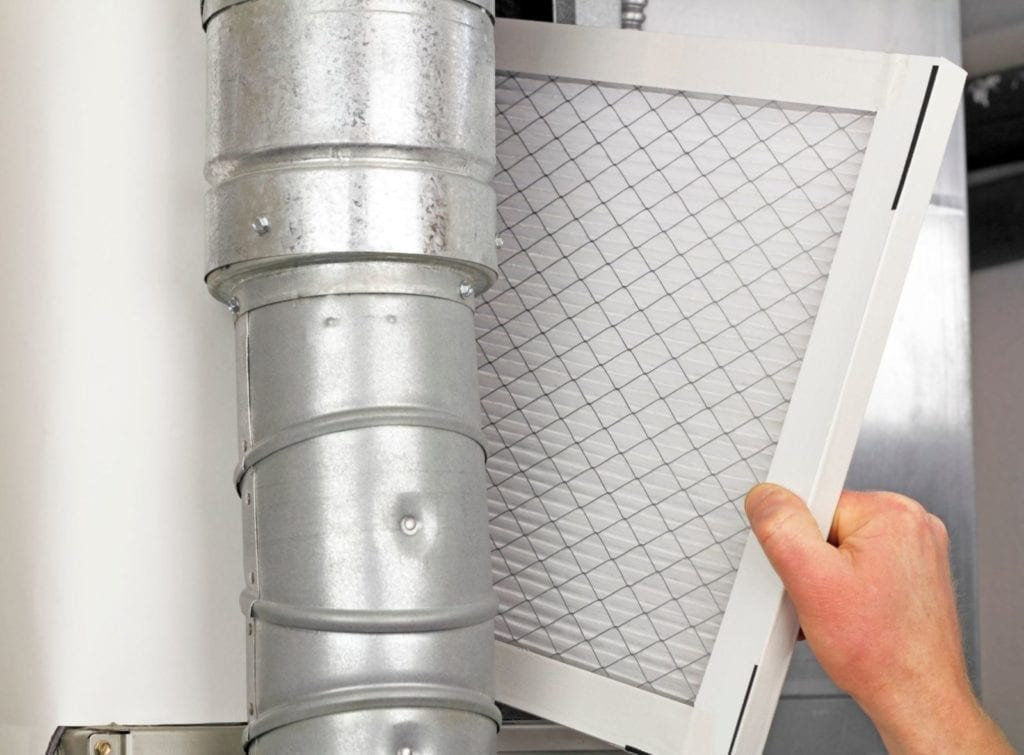 Joe Cool HVAC technician changing air filter in Pinellas Park home